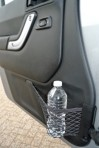 Jeep designers got inspiration for this in-door net when they peeked in car windows and saw a bottle secured with a bungee cord