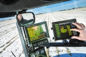 An Iowa farmer using tractor-mounted computers to help make decisions about planting crops