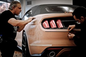 Ford modelers work on a clay prototype of the Mustang