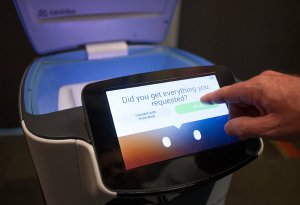 A touch screen on Botlr allows guests to give the robot a review