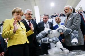 German Chancellor Merkel and Indian Prime Minister Modi with the new YuMi robot