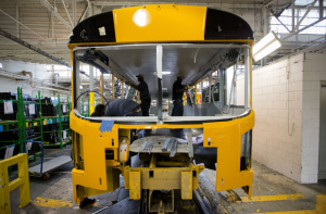 Blue Bird factory workers installing windows on a bus in Fort Valley, Ga. School districts are increasingly ordering propane-fueled buses.