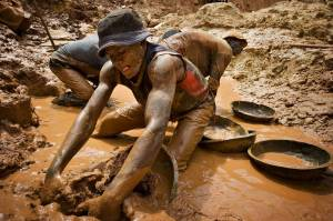 A gold miner digging at an open pit at a mine in the Congo. The Dodd-Frank Act requires companies to disclose whether conflict minerals in their supply chains are connected to violent militia groups in the country.