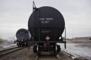 Rail tanker cars sit on tracks at the Red River Supply rail yard in Williston, N.D