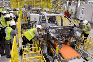 Workers at the Kia plant near Monterrey, Mexico conducted tests on the assembly line, which just opened. last month.