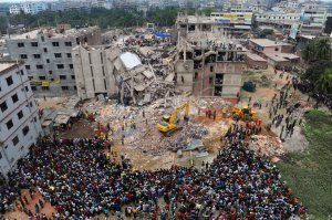 Bangladeshi volunteers and rescue workers at the scene of the Rana Plaza building collapse in April 2013 that killed 1,135 people.