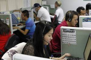As technology improves, an increasing number of the Philippines' 1.2 million call-center workers, such as those shown above in Manila in 2012, will be at risk of having their jobs outsourced to customer-service robots