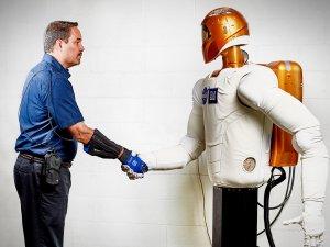 GM worker wearing RoboGlove with Robonaut 2.
