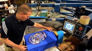 Checks on a Cubs-themed postseason T-shirt Oct. 5, 2016, ahead of the Cubs' first playoff game against the San Francisco Giants