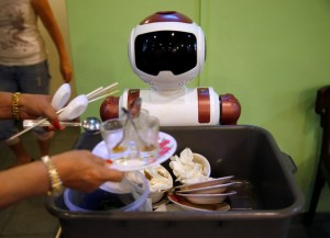 A robot collects dishes to be cleaned at Chilli Padi Nonya Cafe in Singapore