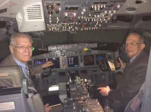 Barry and Jay filming in an Alaska Airlines cockpit