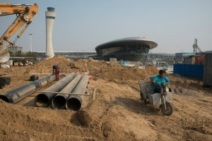 The Chinese government is also spending over $10 billion to build an airport just a few miles from the iPhone factory.