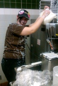 Employees often just say the machine is down rather than reassembling it. Here an employee spills ice cream mix all over herself while trying to fill the machine.