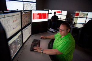 A control room operator for Pioneer Natural Resources in Midland, helping manage all of the company's drilling sites in 21st-century style