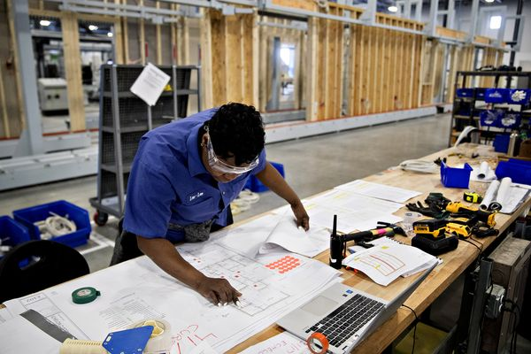 Om in the news robots may build your next house jay barry and an electrician checks her blueprint at baltimores blueprints robotics factory malvernweather Image collections